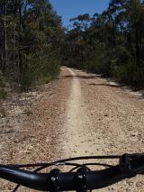 riders point of view - mountain bike ride along a dirt track