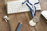 sports science and technology concept with a pair of winning medals