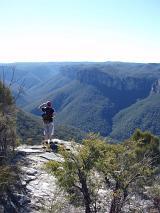 a walker enjoying the view on a wilderness mountain treck