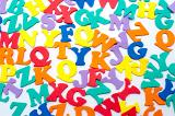 Brightly coloured scattered consonants inan education and learning background for teaching young preschoolers their alphabet